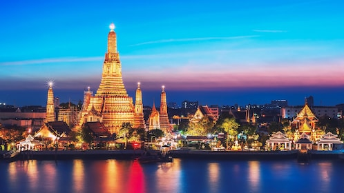 Night view of Wat Arun Temple from river.