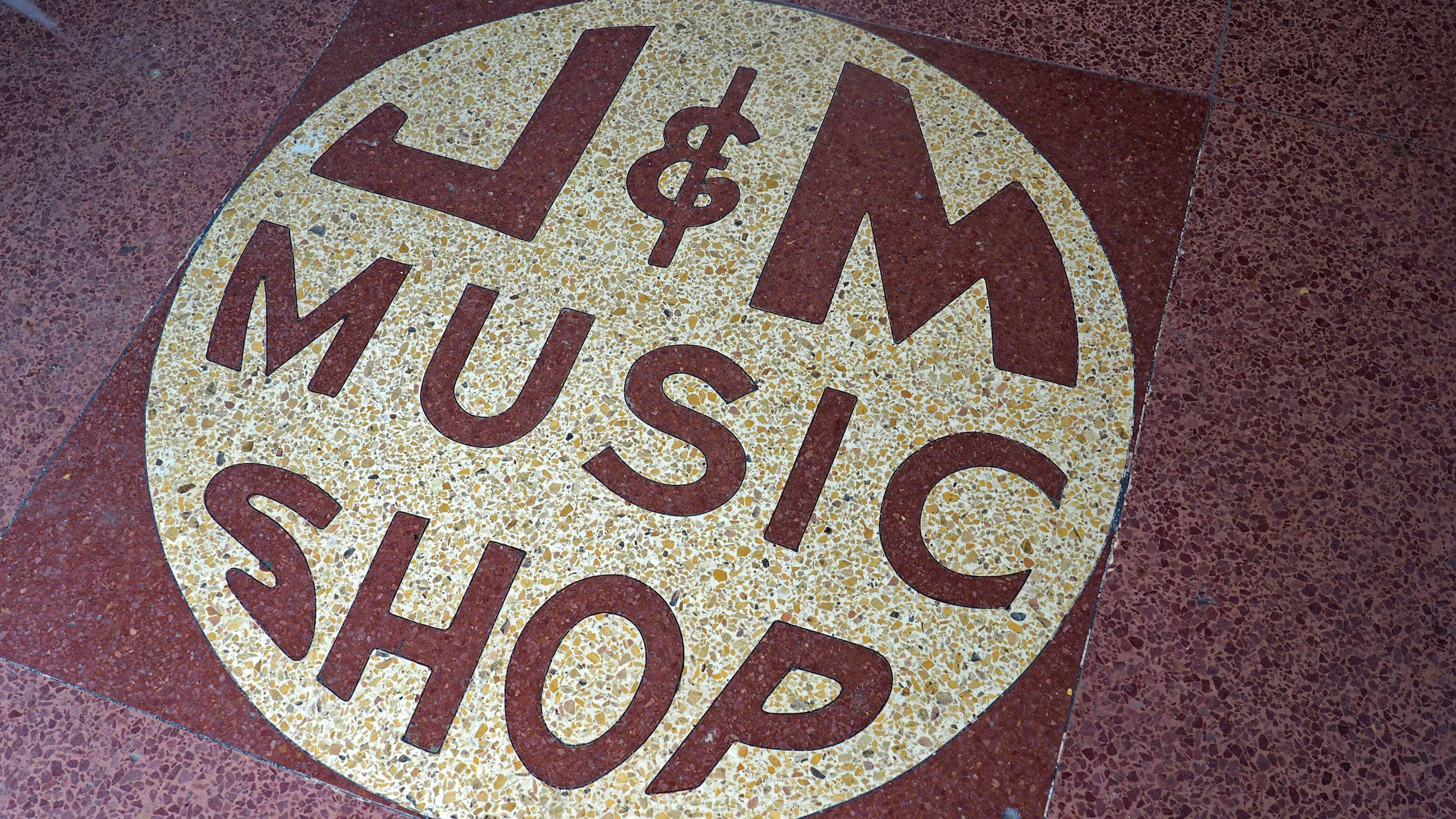J M music shop sign