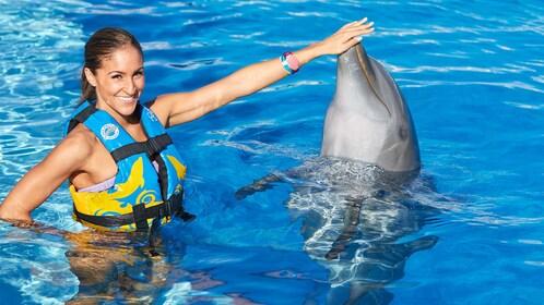 Woman having fun on the dolphin encounter in Panama City, Florida