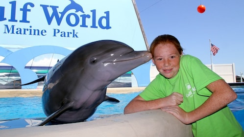 dolphin giving a girl a peck on the cheek in Panama City