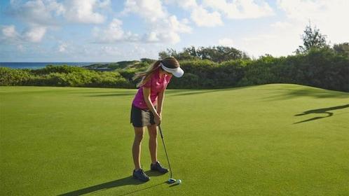 Aim for a hole in while during a round of golf in Oahu