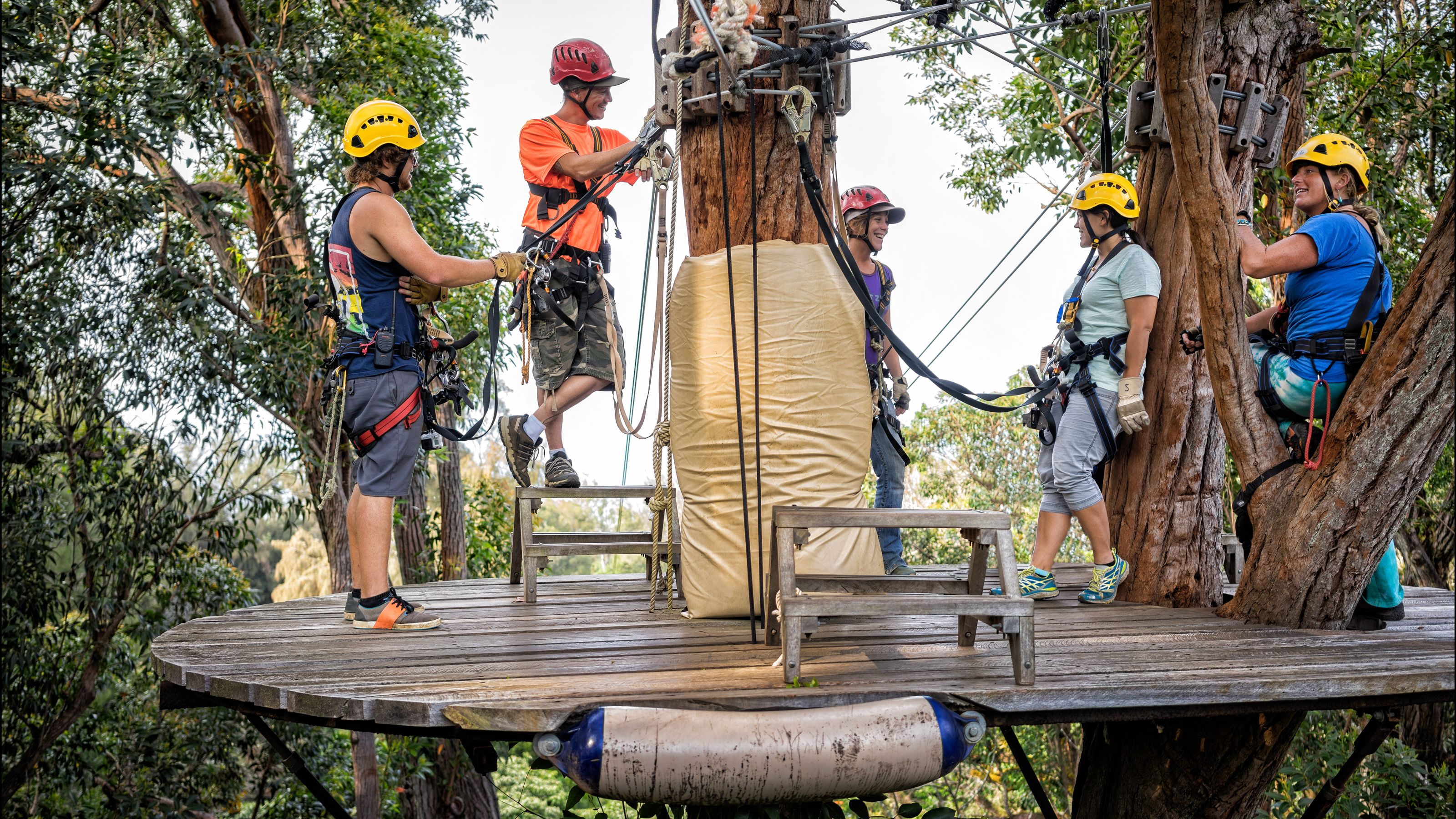People standing on a platform waiting for their turn to zipline in Hawaii