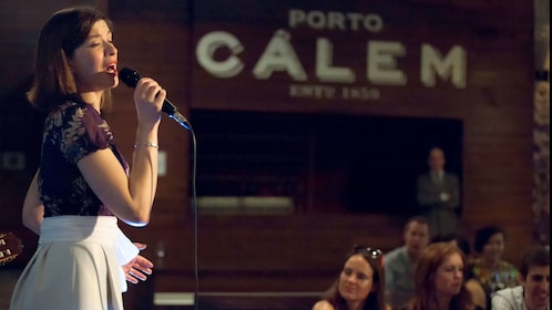Woman singing with audience in Lisbon