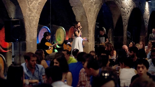 People dining while musicians perform onstage in Lisbon