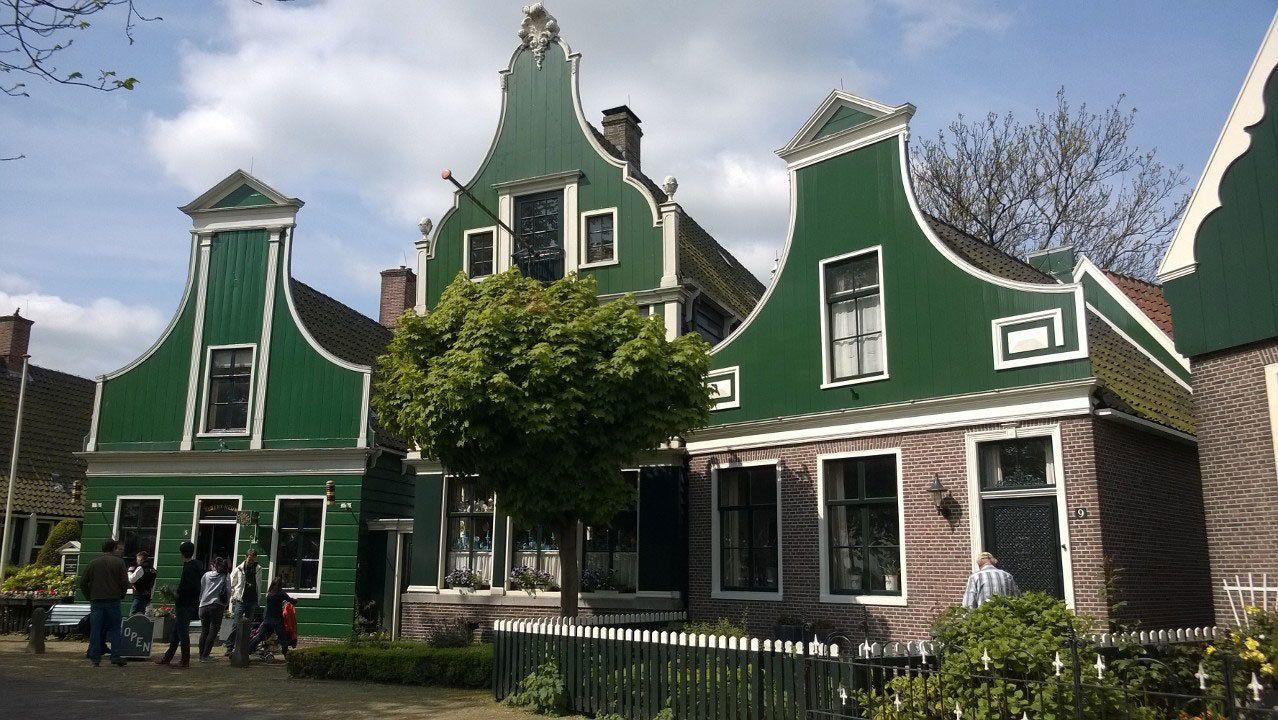 Green and brick buildings in Zaanse Schans