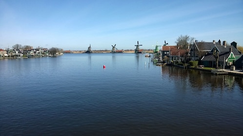 View of town and windmills along the water's edge in Zaanse Schans