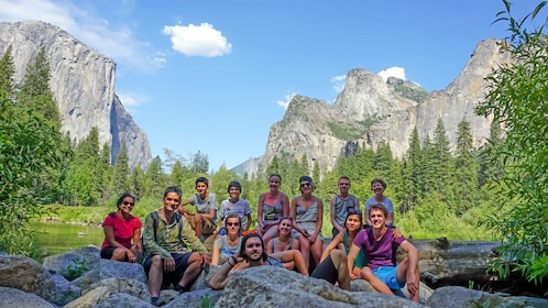 group taking a photo in front of a scenic background at Yosemite