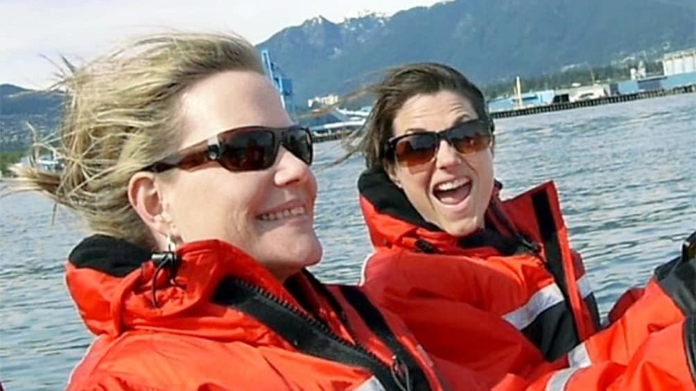 Show item 5 of 6. Two ladies enjoying the whale watching tour in Vancouver BC