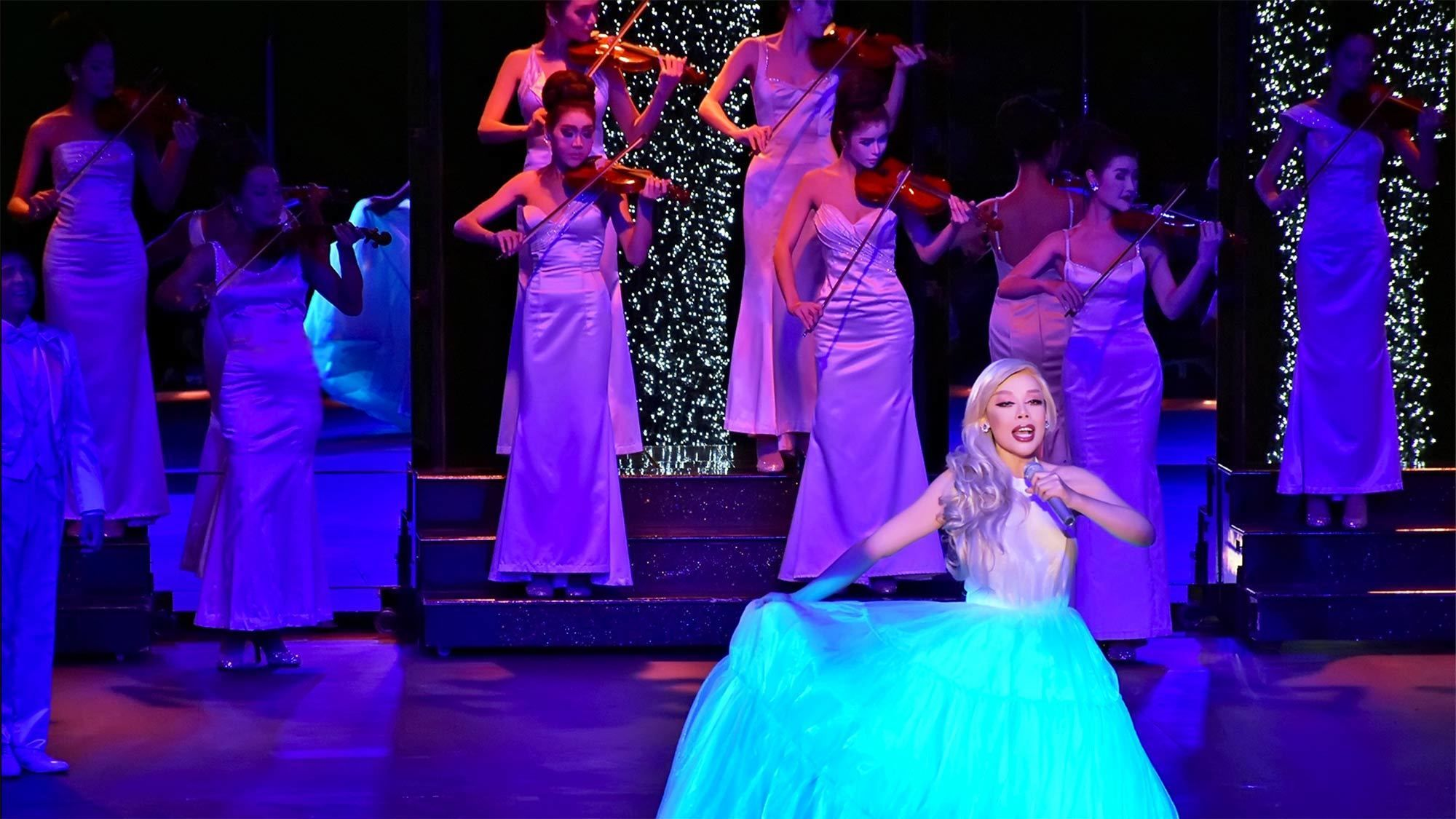 Performer in a bight blue dress at the Calypso Bangkok Cabaret Show in Bangkok, Thailand