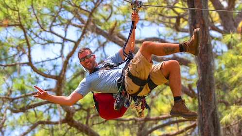 Man suspended from a rope harness at a Florida obstacle course