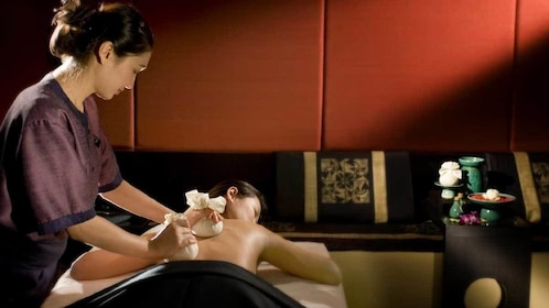 woman receiving a back massage in Koh Samui, Thailand