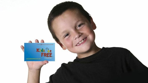Boy holds up a Kids eat Free card