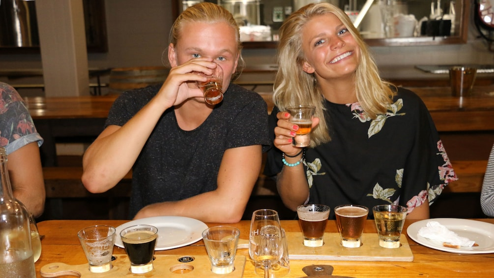 Show item 4 of 10. Couple tasting beer in Sydney
