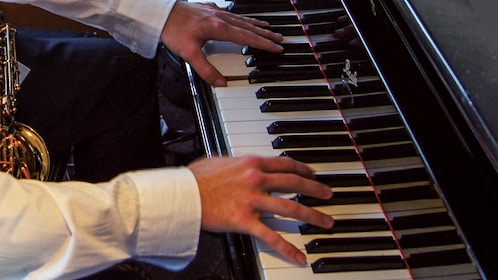 Close up of jazz musician playing piano.