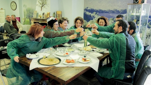 Tour group enjoying a meal on the olive tour in Peloponnese, Greece