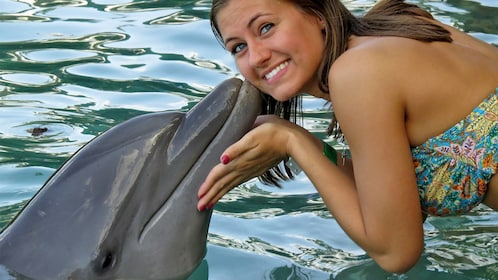 Woman receiving a kiss from a dolphin in Ochos Rios
