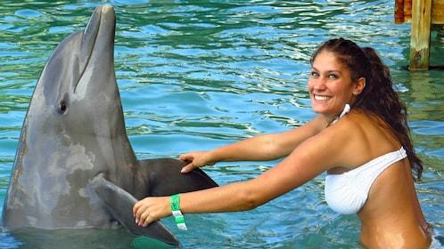 Woman holding a dolphin on a dolphin encounter in Ochos Rios