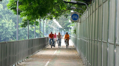 Group of bicyclists ride a bike path in Bangkok Thailand
