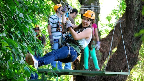 Girl ziplining on the Apaneca Canopy tour in El Salvador, Central America