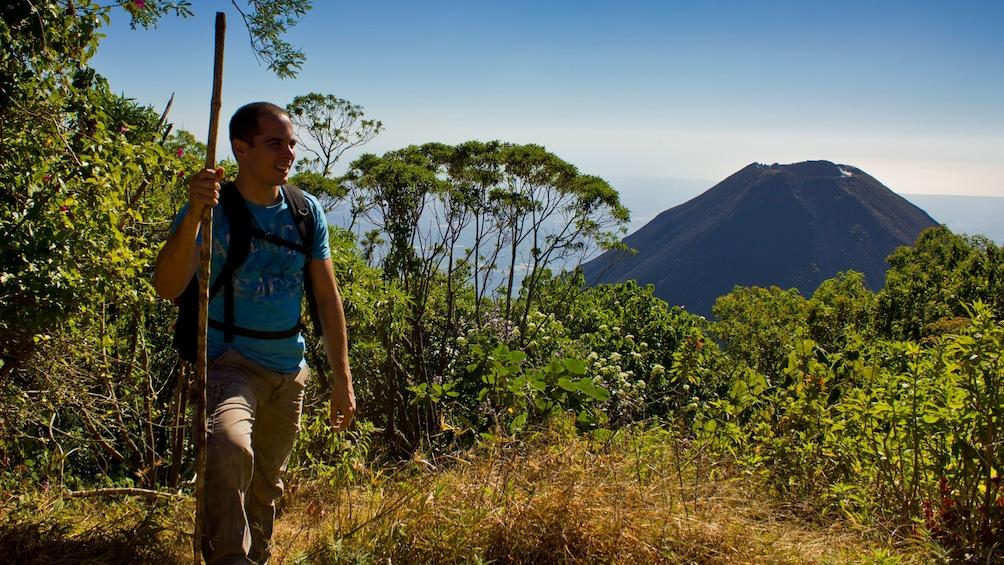 Show item 3 of 5. Man hiking next to Volcano in El Salvador