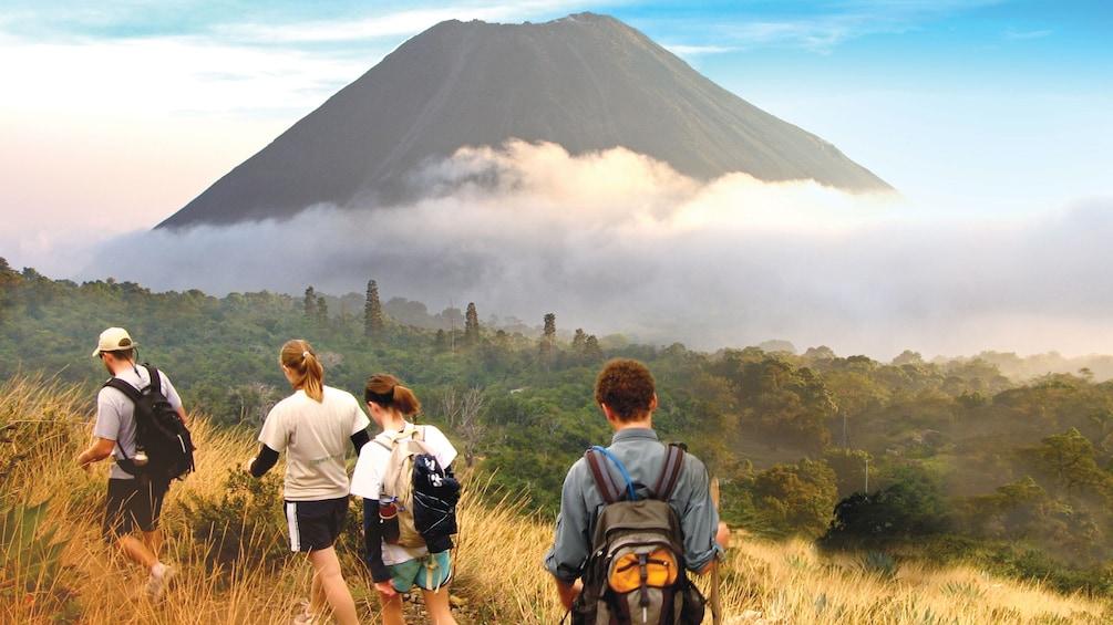Show item 1 of 5. Hikers next to Volcano in El Salvador