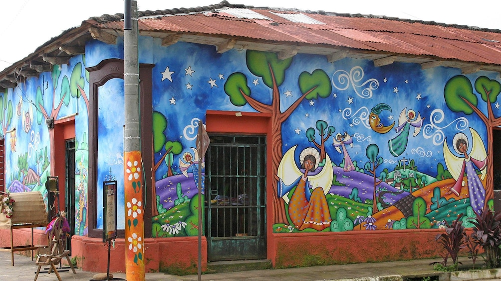 Show item 3 of 8. Vibrant corner view of a building of Concepción de Ataco in El Salvador
