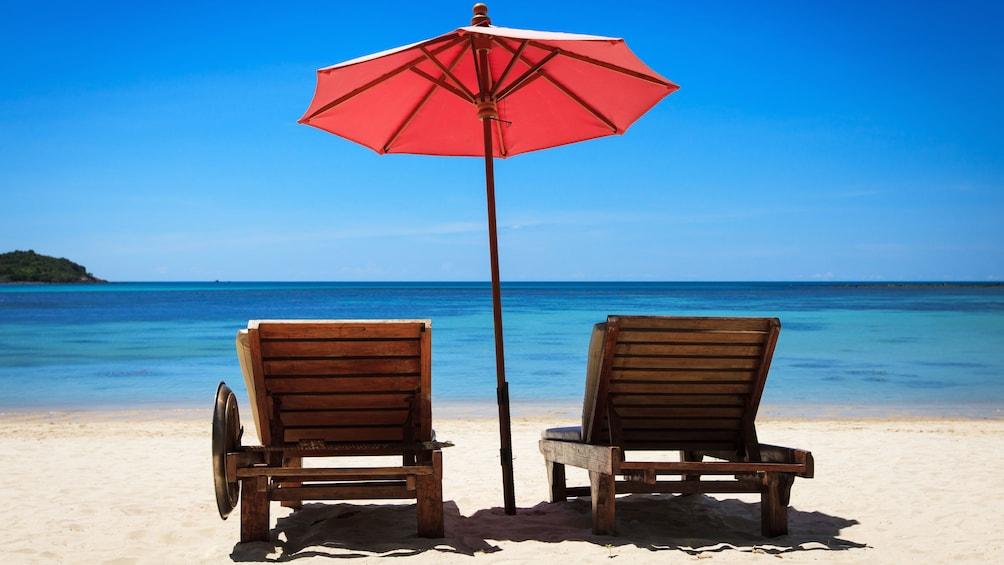 Show item 1 of 4. Beach chairs and umbrella on the Maui coast