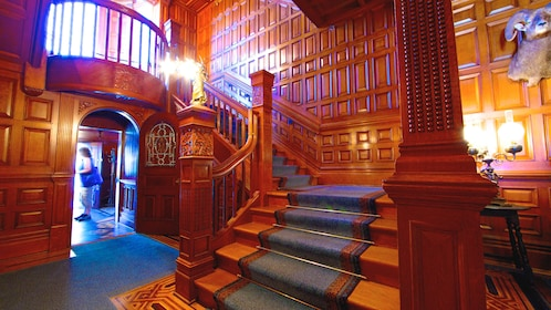 Angled interior view of Craigdarroch Castle staircase.