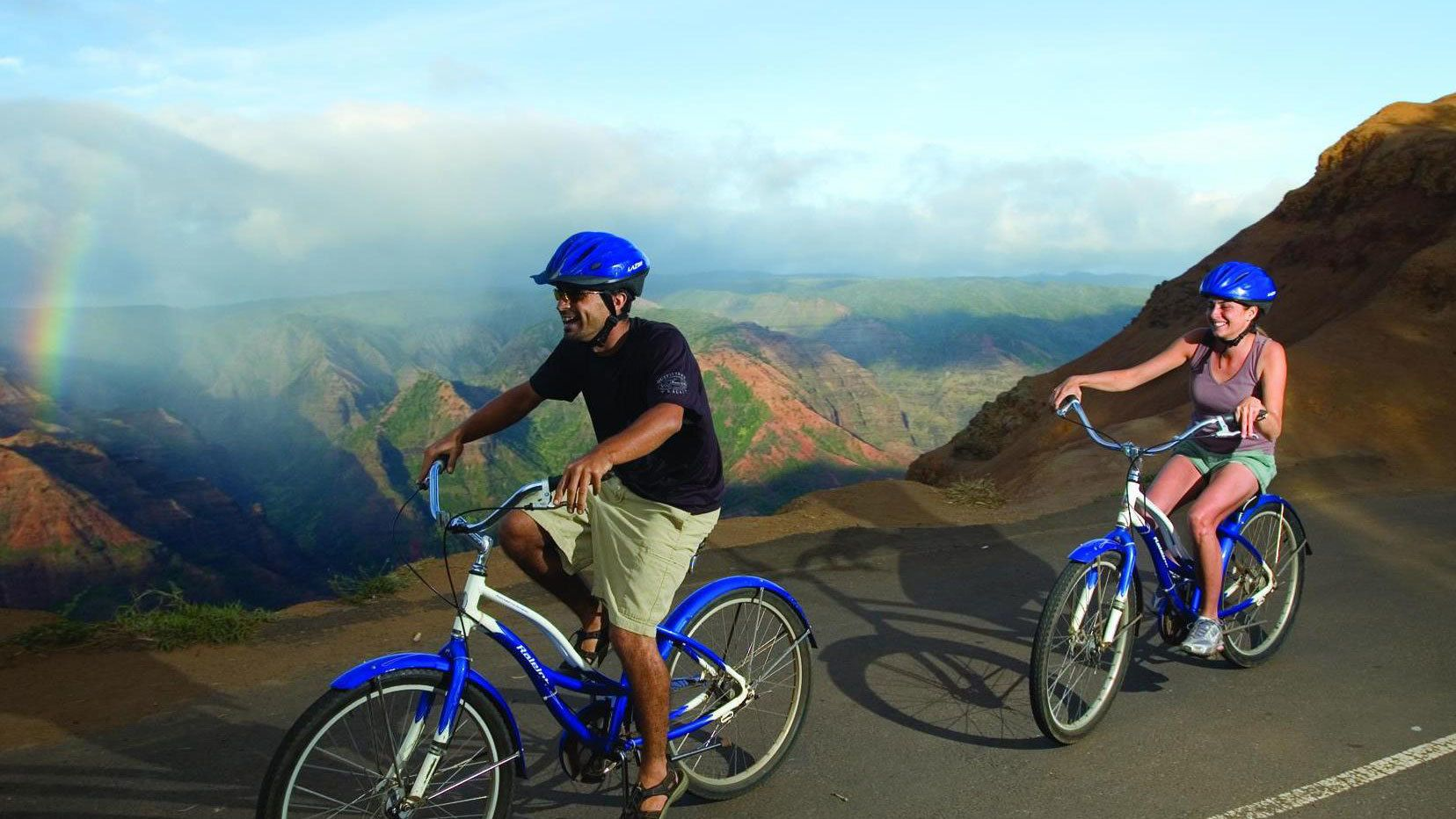 man and woman riding bikes in Kauai