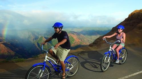 man and woman riding bikes in Kauai