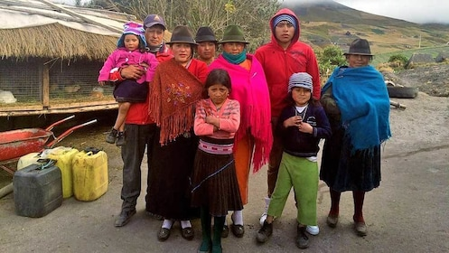 villagers standing for a photo in Quito