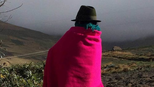 village woman looking out into the misty climate in Quito
