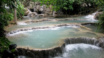 Private Full-Day Kuang Si Falls Tour with Ethnic Villages & Market Visit