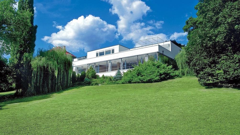 a modern villa on top of a hill