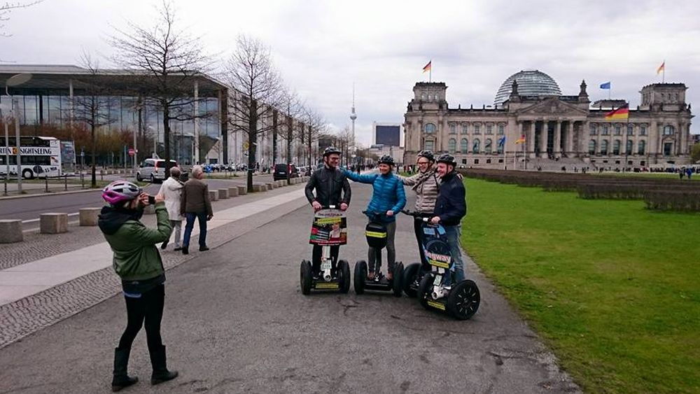 Segway group poses for a picture in front of Reichstag