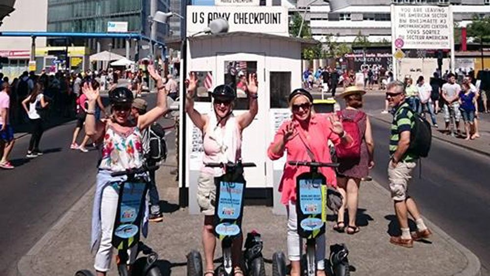 Four people on a Segway tour outside Checkpoint Charlie