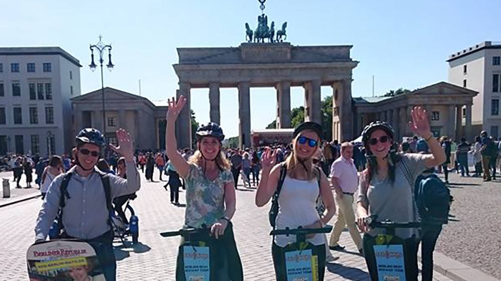Four people on a Segway tour outside the Brandenburg Gate