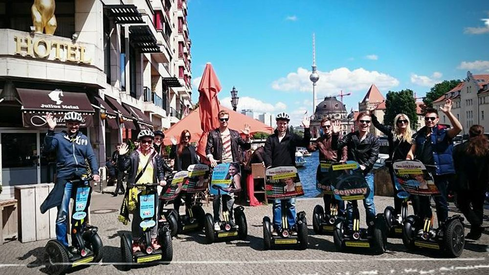Segway tour poses for a picture on the streets of Berlin