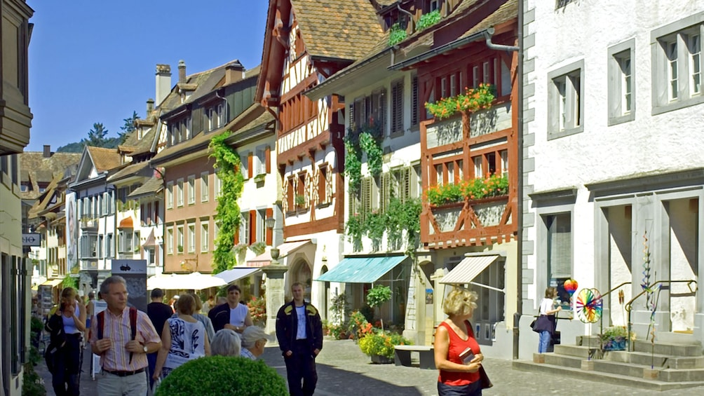 Show item 1 of 9. People walk down the streets of Stein am Rhein