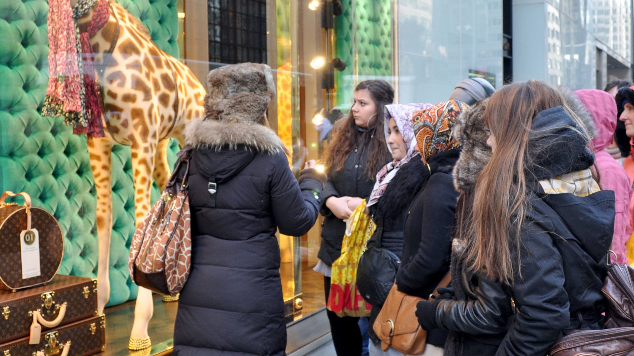 Tour group outside a Fifth Avenue storefront in New York