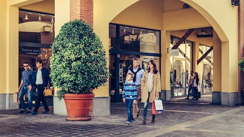 family shopping at an outlet mall in Milan