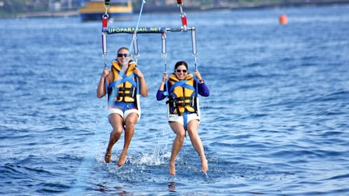 Close view of two people parasailing in Maui