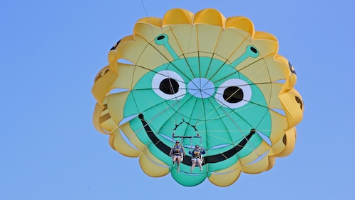 Aerial view of two people parasailing in Maui