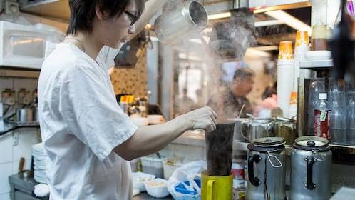 Man preparing food on the Sham Shui Po Foodie Tour in Hong Kong