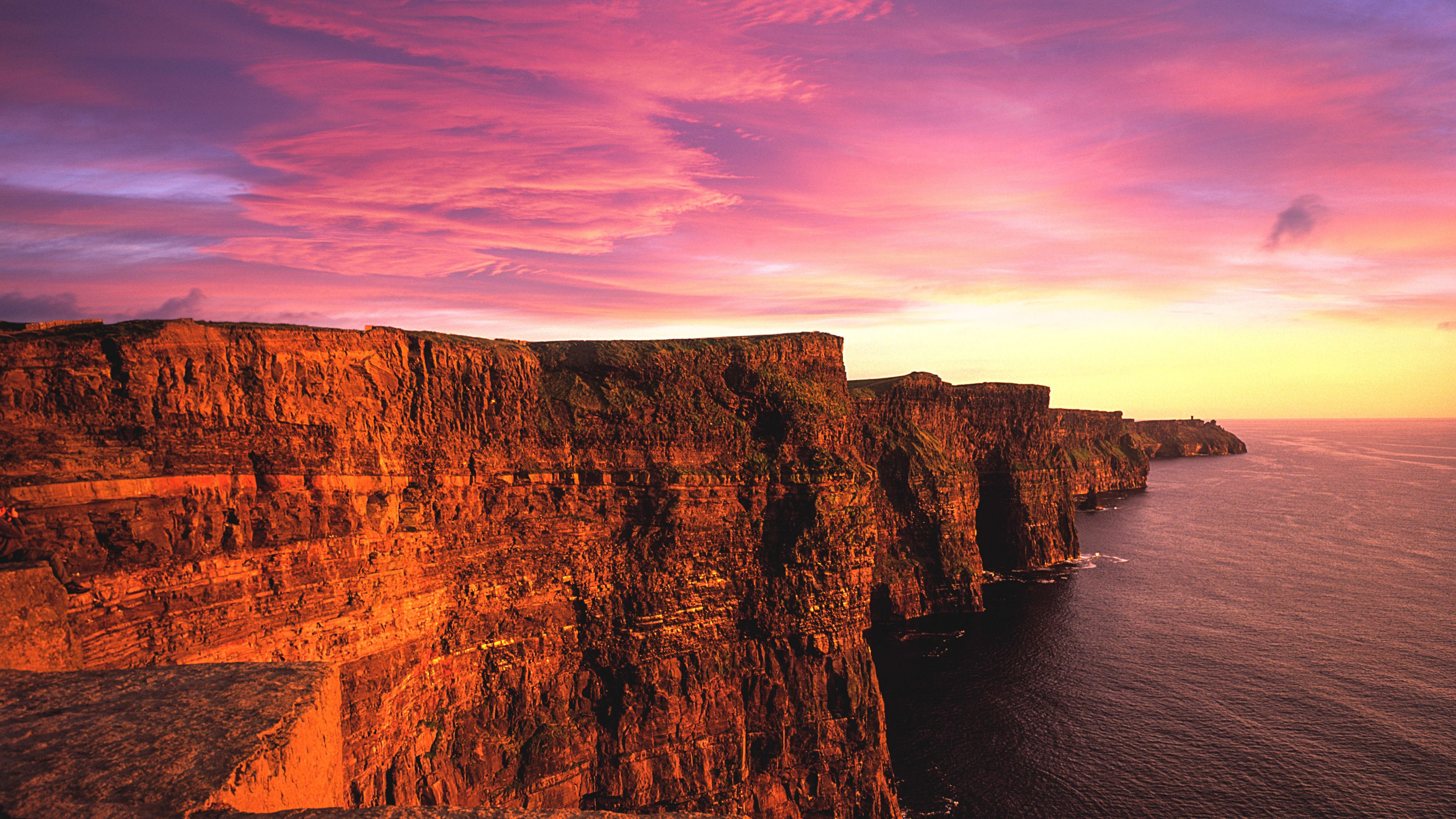 Vibrant sunset view of Cliffs of Moher.