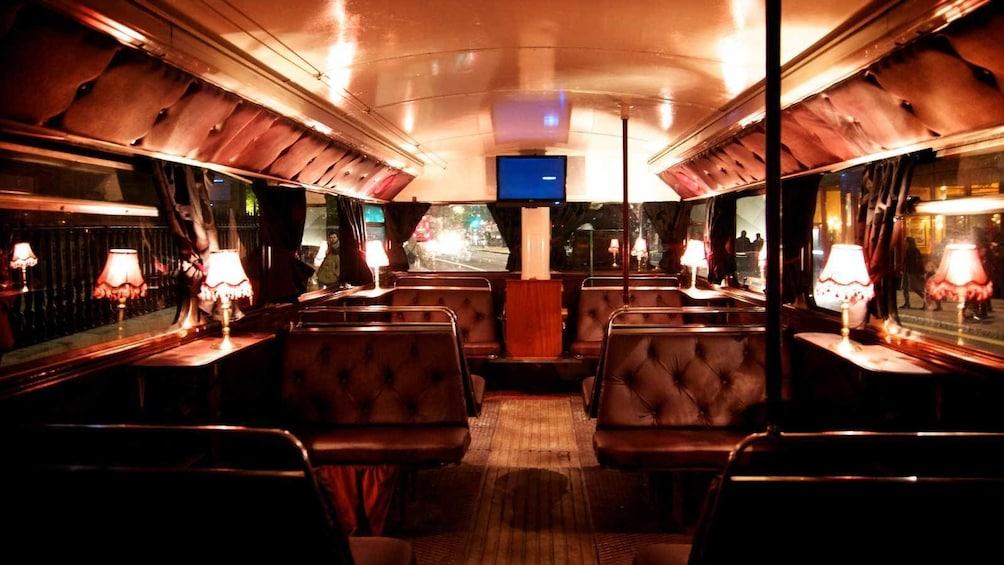 Indlæs billede 5 af 5. inside the dimly lit ghost bus in Edinburgh