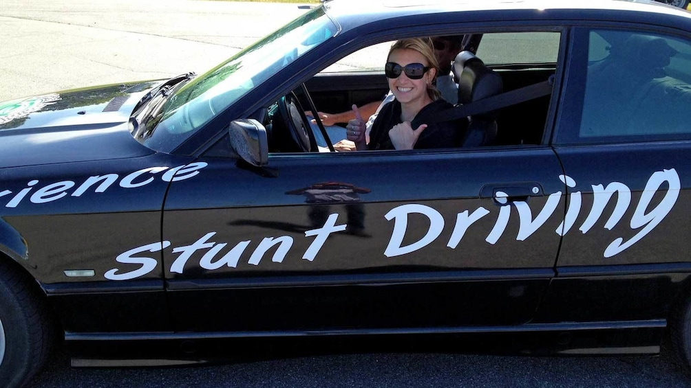 Show item 4 of 5. woman ready to take the wheel in a stunt car in Ontario