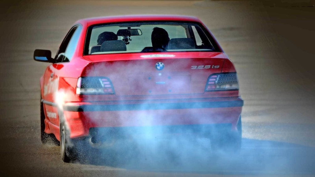 Show item 3 of 5. stunt car kicking up smoke and dust in Ontario