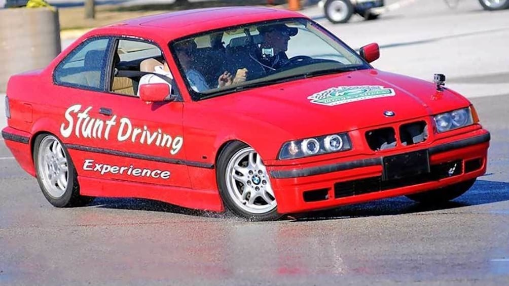 Show item 1 of 5. red stunt car drifting on the wet tracks in Ontario