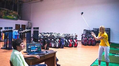 Interior view of rental shop with several golf club available.